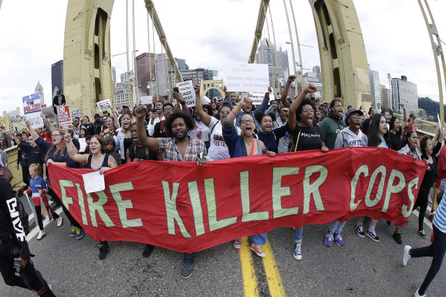 Protesters angry about the killing of Antwon Rose cross Pittsburgh's Roberto Clemente Bridge during an evening rush hour march on June 22. (Photo: Gene J. Puskar/AP)