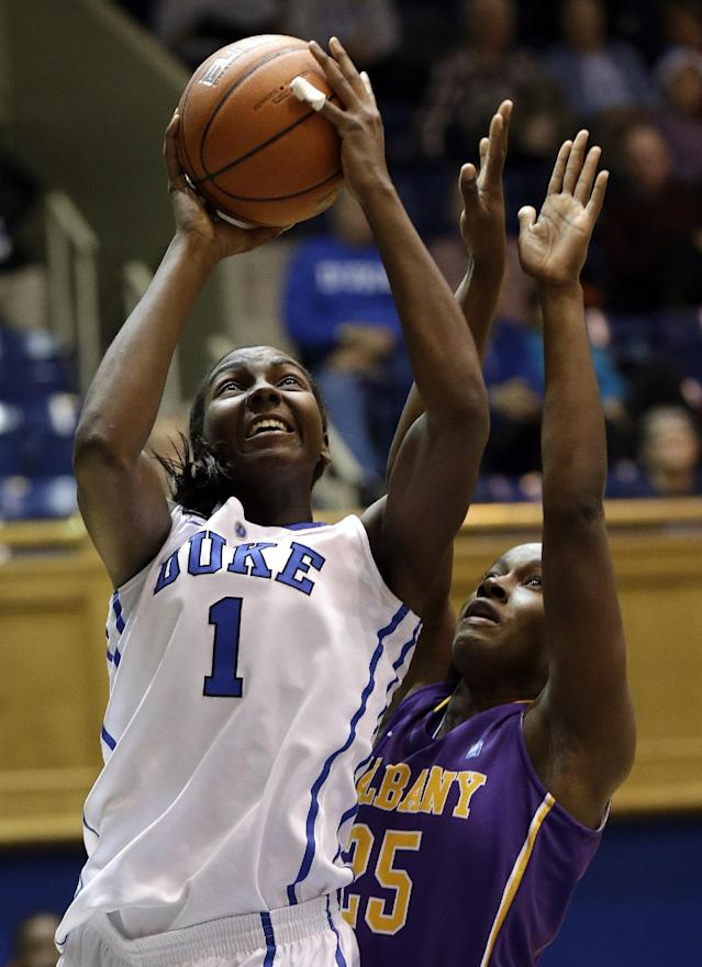 Duke's Elizabeth Williams (1) shoots as Albany's Shereesha Richards (25) defends during the first half of an NCAA college basketball game in Durham, N.C., Thursday, Dec. 19, 2013. (AP Photo/Gerry Broome)