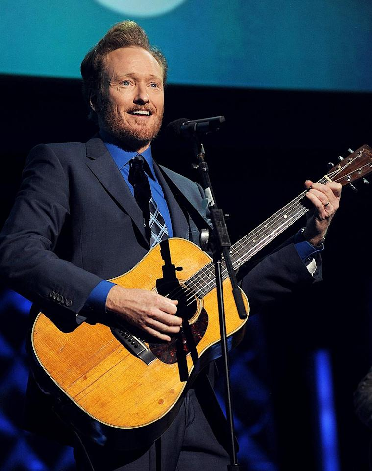 """After joking that the plotlines on """"Lost"""" were more plausible than what happened to him at NBC, Conan O'Brien launched into a rendition of """"On The Road Again"""" with the altered lyrics, """"I just want to be on my own show again."""" Kevin Mazur/<a href=""""http://www.wireimage.com"""" target=""""new"""">WireImage.com</a> - May 19, 2010"""