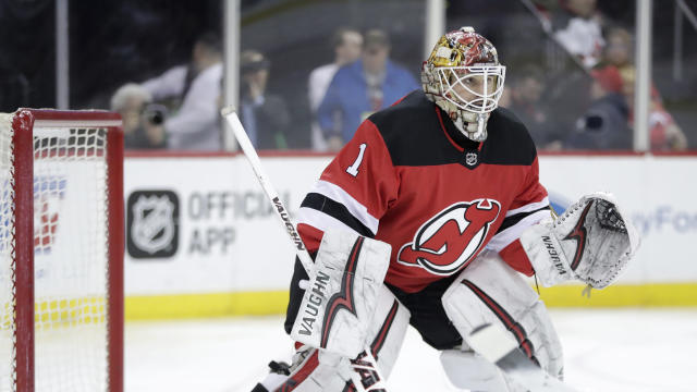 "<a class=""link rapid-noclick-resp"" href=""/nhl/teams/njd"" data-ylk=""slk:New Jersey Devils"">New Jersey Devils</a> goaltender <a class=""link rapid-noclick-resp"" href=""/nhl/players/5316/"" data-ylk=""slk:Keith Kinkaid"">Keith Kinkaid</a> protects his net against the <a class=""link rapid-noclick-resp"" href=""/nhl/teams/pit"" data-ylk=""slk:Pittsburgh Penguins"">Pittsburgh Penguins</a> during the first period of an NHL hockey game, Thursday, March 29, 2018, in Newark, N.J. (AP Photo/Julio Cortez)"
