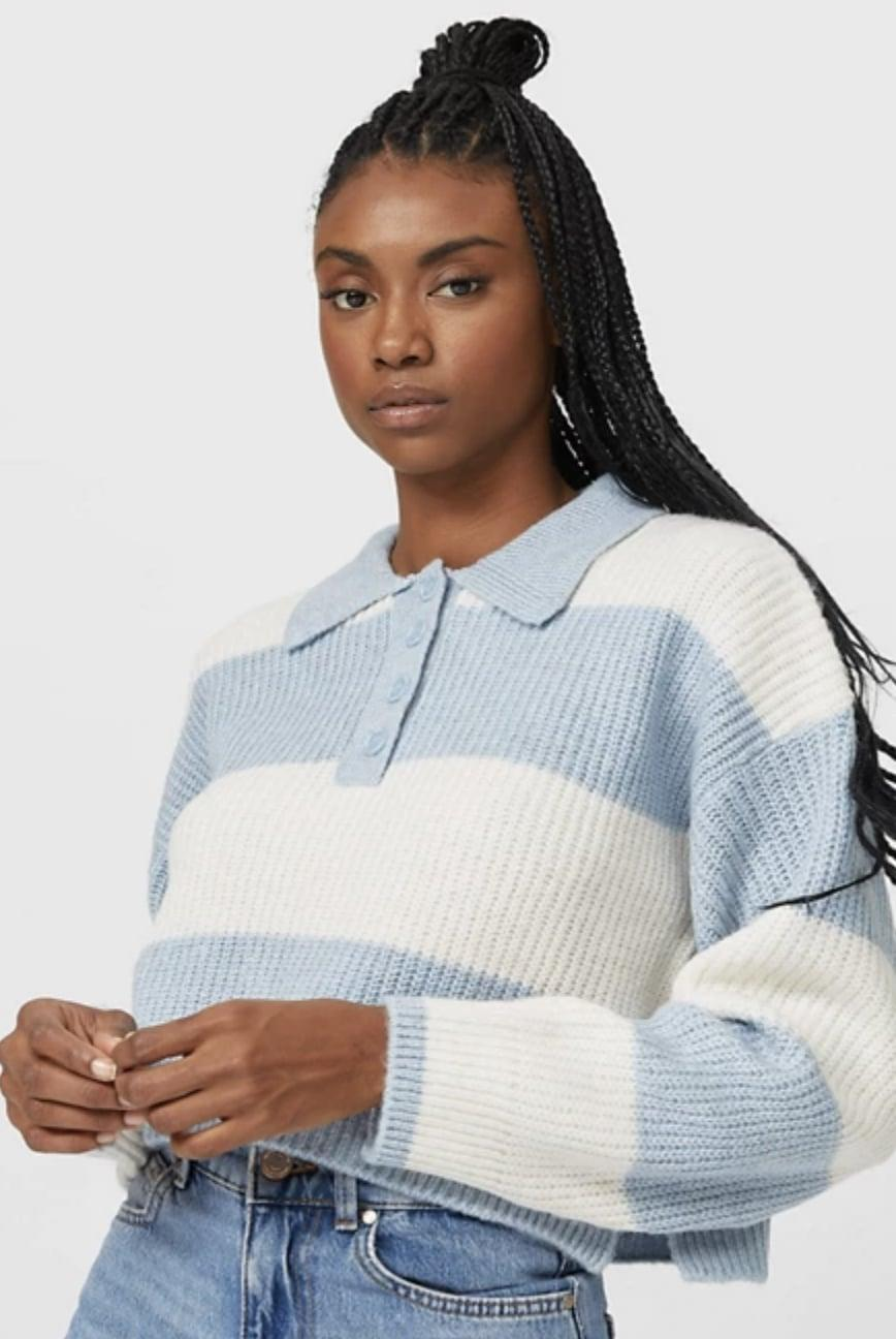 <p>Layer this <span>Stradivarius Ribbed Polo Sweater</span> ($46) over a dress.</p>