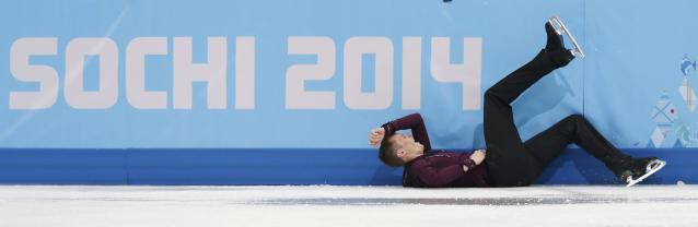 Jeremy Abbott of the U.S. lies on the ice after a fall during the Figure Skating Men's Short Program at the Sochi 2014 Winter Olympics, February 13, 2014. REUTERS/Alexander Demianchuk (RUSSIA - Tags: OLYMPICS SPORT FIGURE SKATING TPX IMAGES OF THE DAY)
