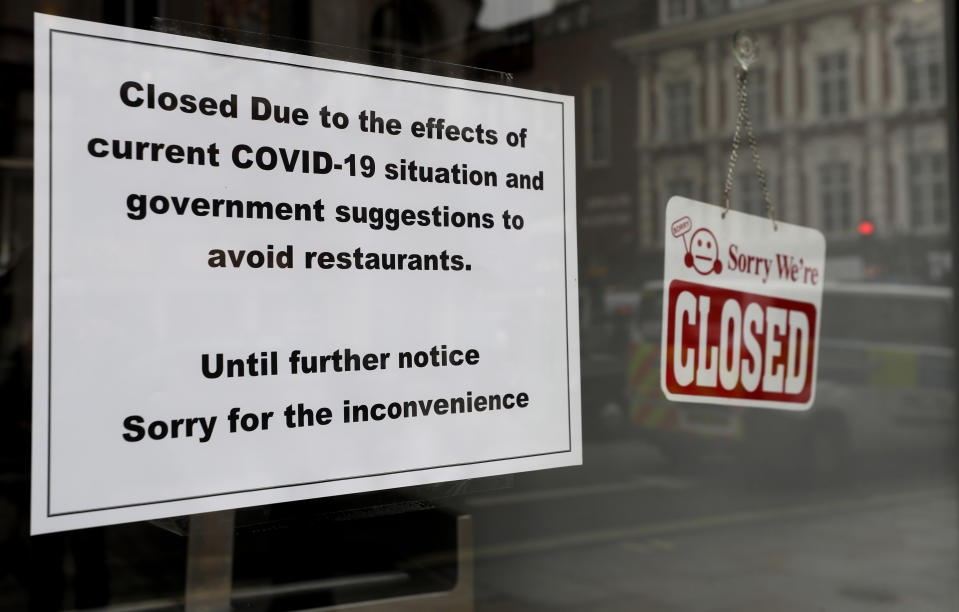 A sign on a closed restaurant in London, Tuesday, March 17, 2020. For most people, the new coronavirus causes only mild or moderate symptoms, such as fever and cough. For some, especially older adults and people with existing health problems, it can cause more severe illness, including pneumonia. (AP Photo/Kirsty Wigglesworth)