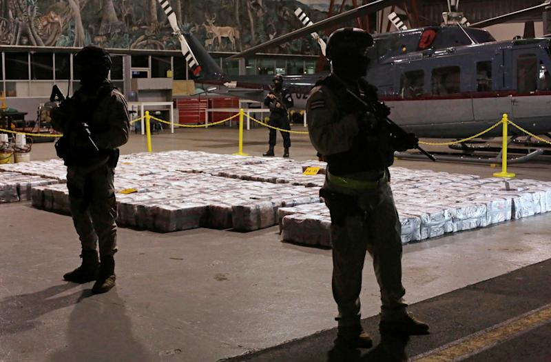 Costa Rican police officers are seen on Saturday February 15, 2020, in front of packages containing cocaine seized during an operation in the Caribbean: Reuters
