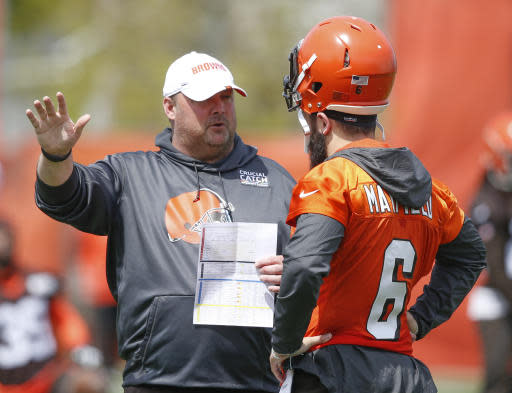 Cleveland Browns head coach Freddie Kitchens talks with quarterback Baker Mayfield during an NFL football organized team activity session at the team's training facility Wednesday, May 15, 2019, in Berea, Ohio. (AP Photo/Ron Schwane)