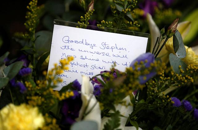 <p>A floral tribute left outside Great St Marys Church, where the funeral of theoretical physicist Prof Stephen Hawking is being held, in Cambridge, Britain, March 31, 2018. (Photo: Henry Nicholls/Reuters) </p>