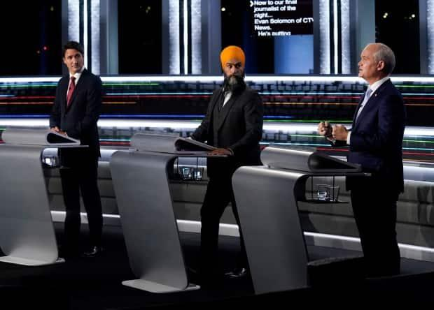 Liberal Leader Justin Trudeau, left, NDP Leader Jagmeet Singh, centre, and Conservative Leader Erin O'Toole all believe their parties could pick up seats in the areas in and around Vancouver on election night.  (Adrian Wyld/The Canadian Press - image credit)