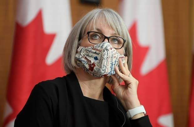 Minister of Health Patty Hajdu uses a translation headset as she listens to a speaker via video conference at a news conference on December 1, 2020 in Ottawa. (Adrian Wyld/The Canadian Press - image credit)