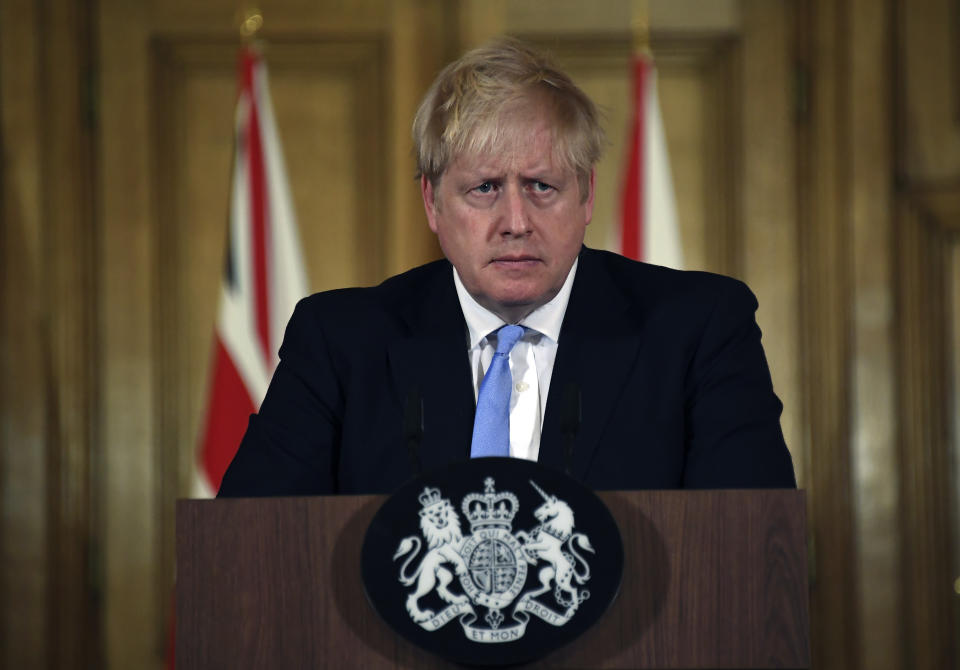 Britain's Prime Minister Boris Johnson speaks during a press conference about coronavirus in 10 Downing Street in London, Monday, March 9, 2020. (AP Photo/Alberto Pezzali)