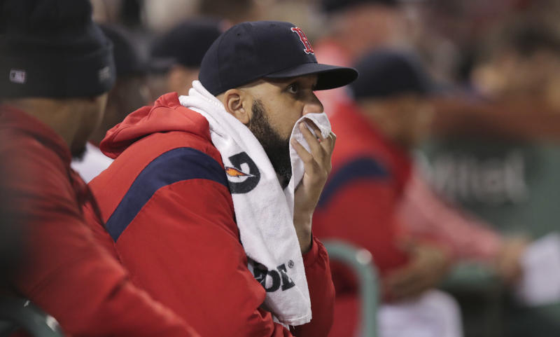 Boston Red Sox starting pitcher David Price watches a game against the San Francisco Giants from the dugout during the sixth inning of a baseball game at Fenway Park in Boston, Tuesday, Sept. 17, 2019. (AP Photo/Charles Krupa)
