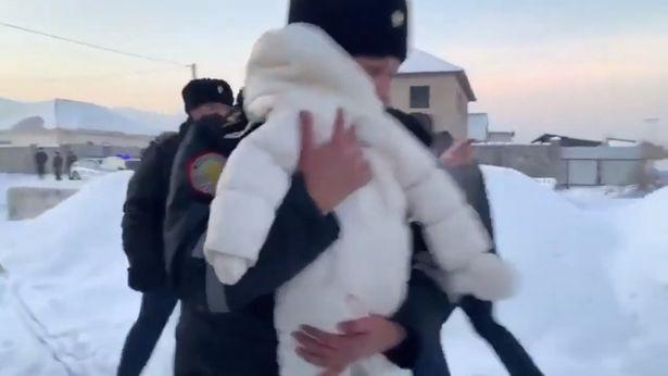 A rescuer saved a baby from the crash (Picture: Sky News)