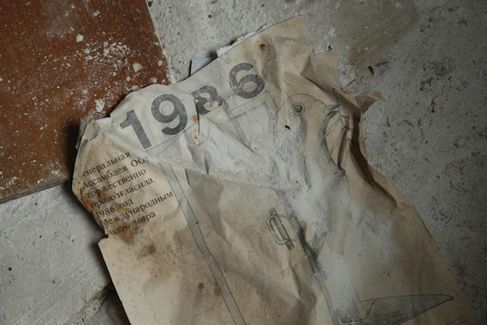 <p>A calendar from the fateful year 1986 lies on the floor of a former hospital (Getty Images) </p>