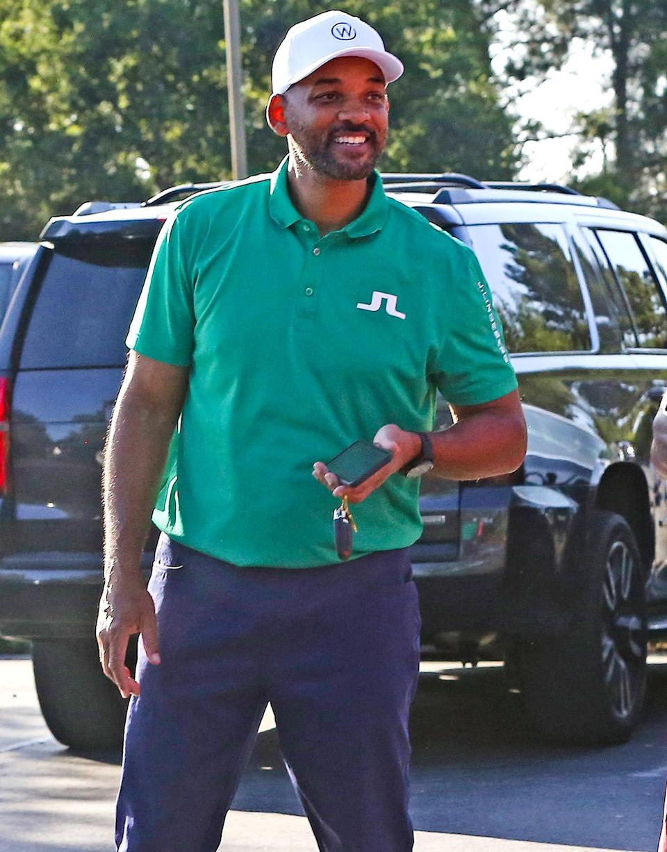 <p>A smiling Will Smith visits a golf course in Los Angeles on Thursday.</p>