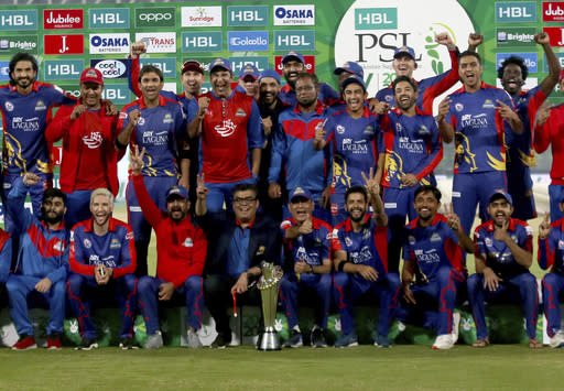 Karachi Kings officials and players pose with the winning trophy after the final of the Pakistan Super League T20 cricket match against Lahore Qalandars at National Stadium in Karachi, Pakistan, Tuesday, Nov. 17, 2020. (AP Photo/Fareed Khan)