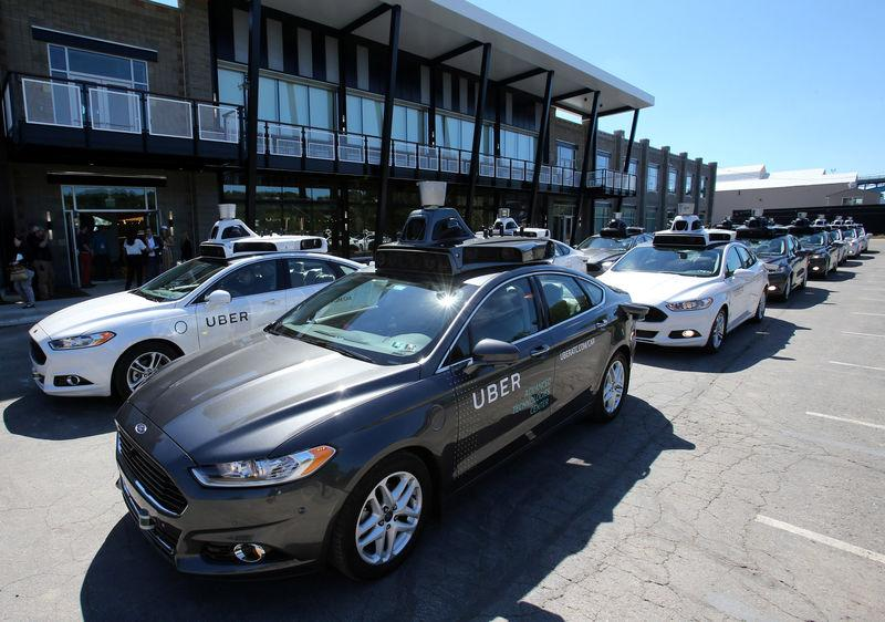 A fleet of Uber's Ford Fusion self driving cars are shown during a demonstration of self-driving automotive technology in Pittsburgh