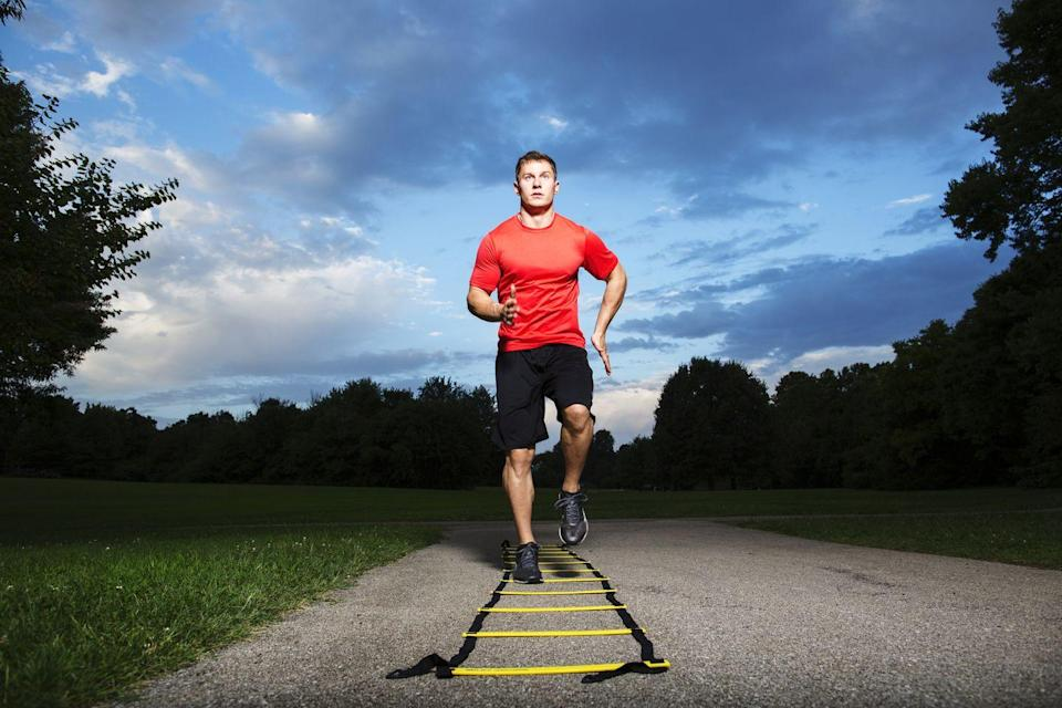 "<p>You'll burn a ton of calories with the short bursts of speed, balance, and coordination it takes to finish a full agility ladder circuit—especially if you run through the drills continuously with limited rest.</p><p>But your brain might get the best benefit from this type of cardio exercise. A 2014 study from the Air Force Research Laboratory showed that <a href=""https://www.menshealth.com/fitness/a19533621/workout-helps-you-think-fast/"" rel=""nofollow noopener"" target=""_blank"" data-ylk=""slk:agility training can improve cognitive performance"" class=""link rapid-noclick-resp"">agility training can improve cognitive performance</a> along with boosting cardio levels. Instead of just plodding mindlessly along on a run, agility drills help you hone your VO2 max, athletic footwork, memory, and concentration. </p>"
