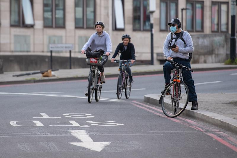 Cyclists ride in Waterloo, London, as the UK continues in lockdown to help curb the spread of the coronavirus.