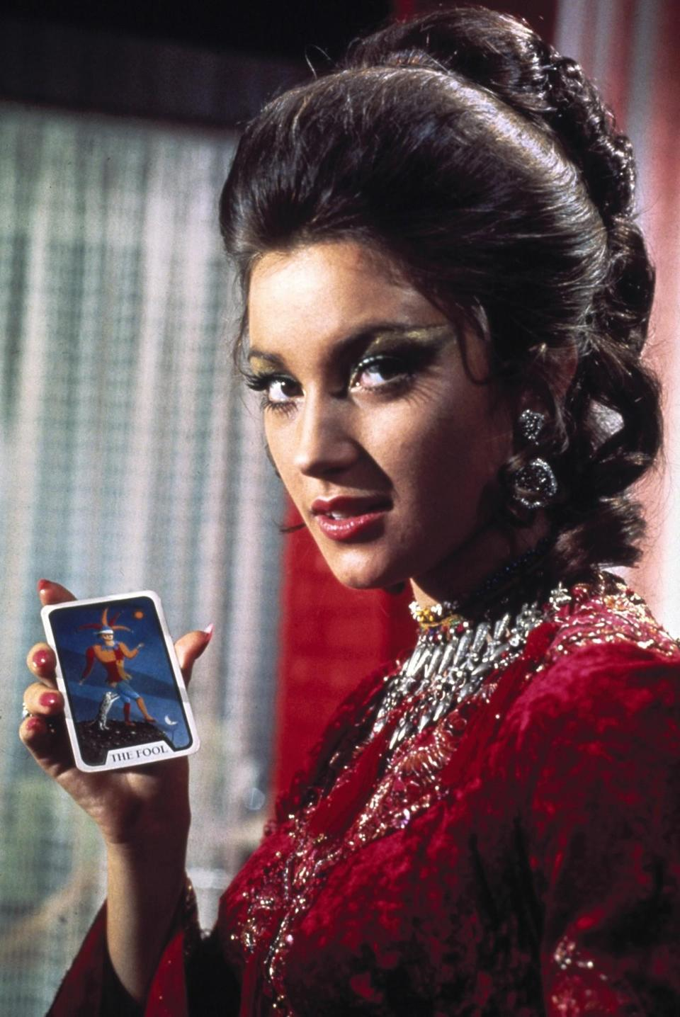 <p>As the youngest bond girl ever — she was only 22 years old — Seymour played an enchanting psychic and Tarot card reader, aptly named Solitaire, whose abilities are mysteriously lost when she loses her virginity to James Bond. Yeah, just go with it. <i>(Photo: Everett Collection)</i></p>