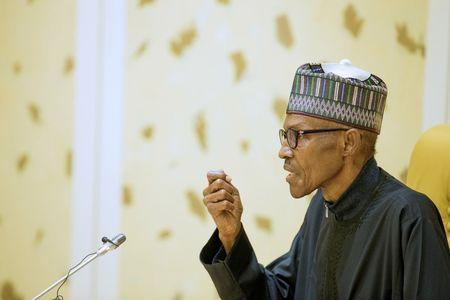 Nigeria's President Muhammadu Buhari speaks after returning from a medical trip from London to Abuja