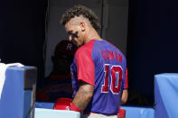 Dominican Republic's Jeison Guzman (10) walks in the dugout following a game against the United States at the 2020 Summer Olympics, Wednesday, Aug. 4, 2021, in Yokohama, Japan. (AP Photo/Sue Ogrocki)