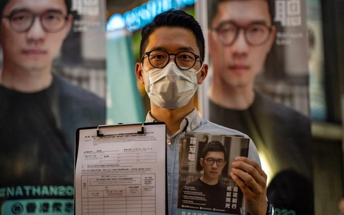 Pro-democracy activist Nathan Law, at one of his last press conferences in Hong Kong last month, says that he will fight for human rights in the former colony from his London base - Anthony Kwan/Getty Images AsiaPac