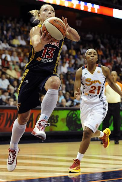 Indiana Fever's Erin Phillips (13) goes up for a basket while pursued by Connecticut Sun's Renee Montgomery during the first half of Game 1 of the WNBA basketball Eastern Conference Finals in Uncasville, Conn., Friday, Oct. 5, 2012. (AP Photo/Jessica Hill)