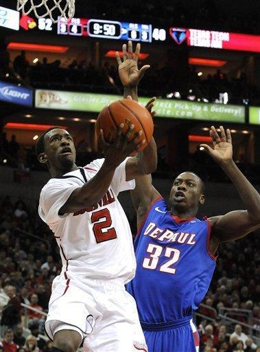 Louisville's Russ Smith (2) puts up a shot past DePaul's Charles McKinney (32) during the second half of their NCAA college basketball game Saturday, Jan. 14, 2012 in Louisville, Ky. Louisville defeated DePaul 76-59. (AP Photo/Timothy D. Easley)