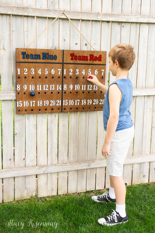 """<p>If Dad's got a competitive streak, he'll love this. Summer is almost here, and there will be<a href=""""https://www.womansday.com/life/g27466255/outdoor-games-for-kids/"""" rel=""""nofollow noopener"""" target=""""_blank"""" data-ylk=""""slk:plenty of backyard games"""" class=""""link rapid-noclick-resp""""> plenty of backyard games</a> of volleyball, badminton, cornhole, and more. Dad (and the kids) will love being able to keep score with this homemade scoreboard. <br><em><br>Get the tutorial at <a href=""""https://www.notjustahousewife.net/diy-outdoor-scoreboard/"""" rel=""""nofollow noopener"""" target=""""_blank"""" data-ylk=""""slk:Not Just a Housewife"""" class=""""link rapid-noclick-resp"""">Not Just a Housewife</a>. </em></p>"""