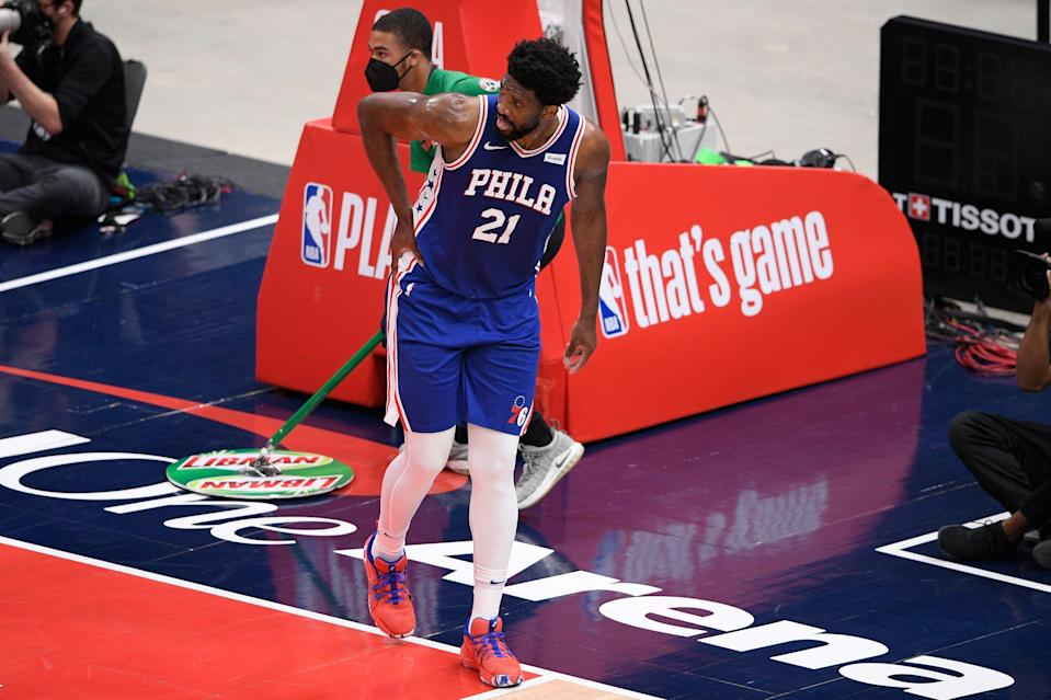 Philadelphia 76ers center Joel Embiid (21) reacts after he fell onto the court during the first half of Game 4 in a first-round NBA basketball playoff series against the Washington Wizards.