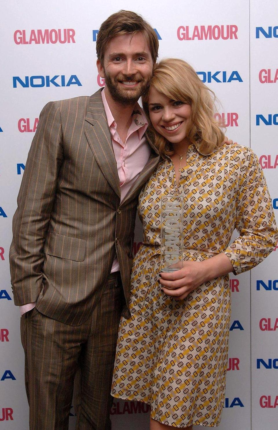 Billie Piper wins UK TV Actress of the Year, presented by David Tennant (left), during the Glamour Women of the Year Awards, at Berkeley Square, central London.. (Photo by Ian West - PA Images/PA Images via Getty Images)
