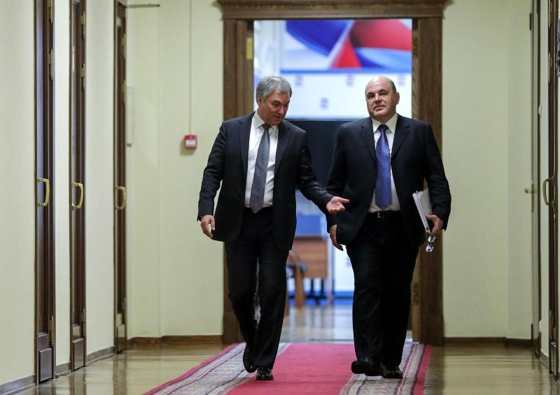 Russia's State Duma Speaker Vyacheslav Volodin and Mikhail Mishustin, who was nominated by Russian President Vladimir Putin as the candidate for the post of Prime Minister, walk before a meeting at the State Duma in Moscow