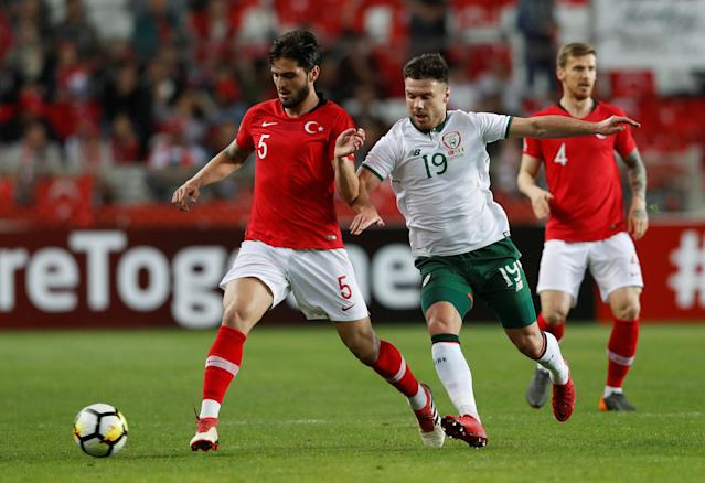 Soccer Football - International Friendly - Turkey vs Republic of Ireland - New Antalya Stadium, Antalya, Turkey - March 23, 2018 Turkey's Okay Yokuslu in action with Republic of Ireland's Scott Hogan REUTERS/Murad Sezer