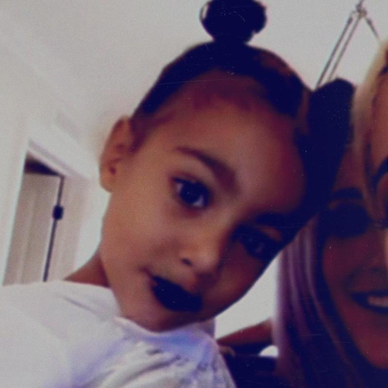 Giving aunt Kylie a run for her lip empire money with goth black lips.