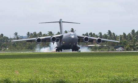A Royal Australian Air Force C-17A aircraft lands at Fiji's Nausori International Airport near Suva to assist in Cyclone Winston recovery efforts, in this picture supplied by the Australian Defence Force, February 24, 2016. REUTERS/Australian Defence Force/Handout via Reuters