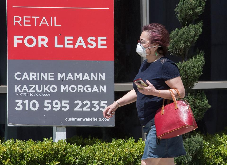 People walk past empty stores and restaurants closed due to impact of the Coronavirus (Covid-19) in Beverly Hills, California on May 8, 2020. - An unprecedented 20.5 million jobs were destroyed in April in the world's largest economy, the biggest amount ever recorded, the Labor Department said in a report released Friday, the first to capture the impact of a full month of the lockdowns. (Photo by Mark RALSTON / AFP) (Photo by MARK RALSTON/AFP via Getty Images)