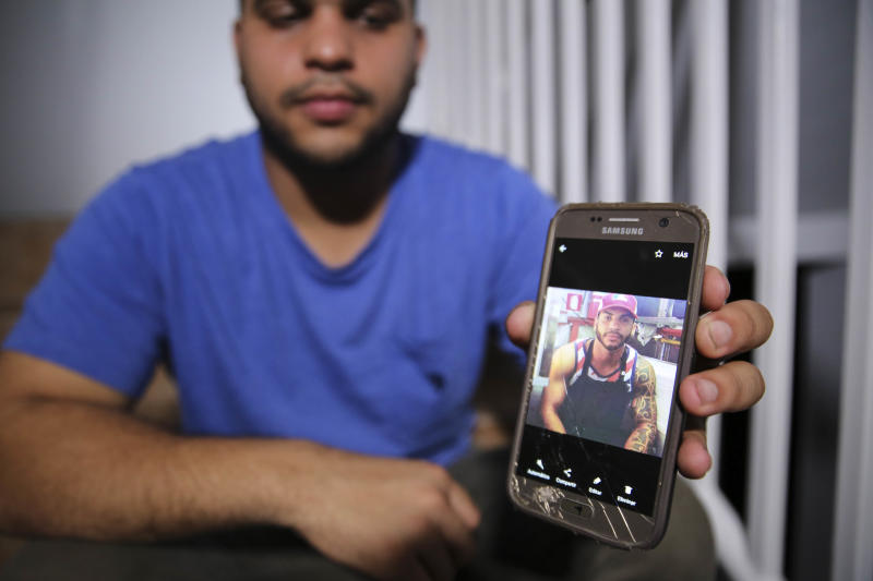 Christian Romero shows HuffPost a photo of his late brother Romsy on Oct. 14, 2017. The family says doctors believe he died after being infected with leptospirosis. (Carolina Moreno/HuffPost)
