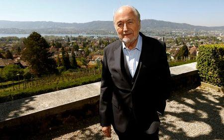 Former FIFA President Blatter poses for photographers in Zurich