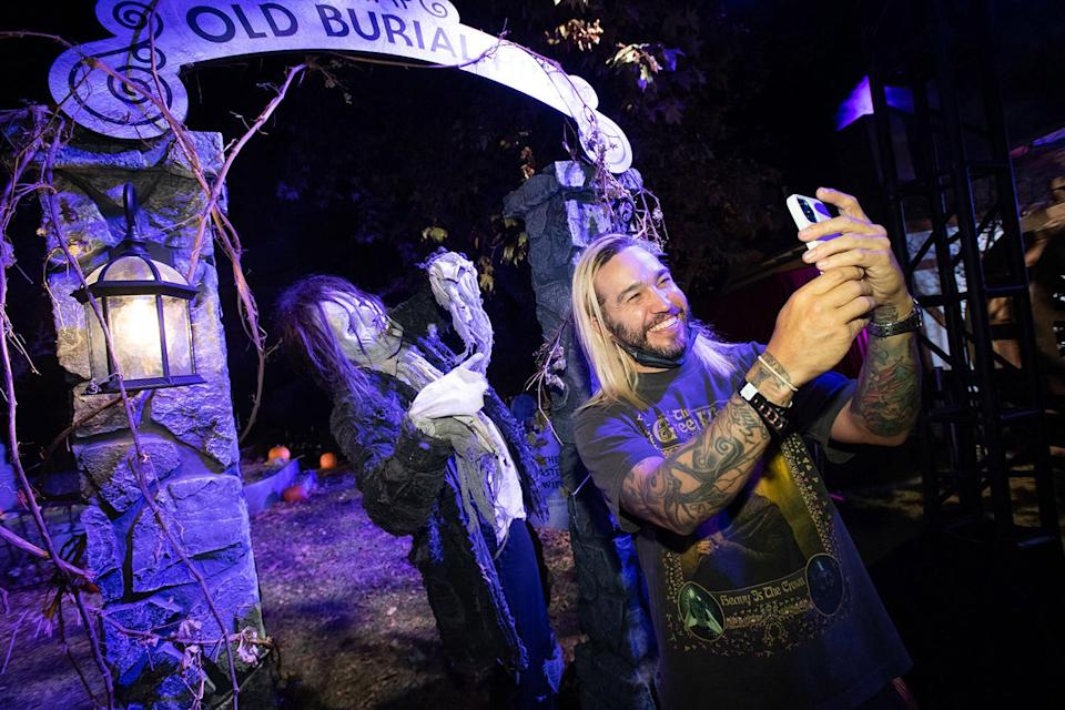 """<p>taking selfies with some ghouls at Freeform's 2021 Halloween Road event in celebration of """"31 Nights of Halloween"""" in L.A. on Oct. 1.</p>"""