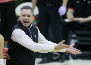 Ohio State head coach Chris Holtmann continues to argue after being whistled for a technical foul during the second half of an NCAA college basketball game against Michigan State Thursday, Feb. 25, 2021, in East Lansing, Mich. (AP Photo/Duane Burleson)