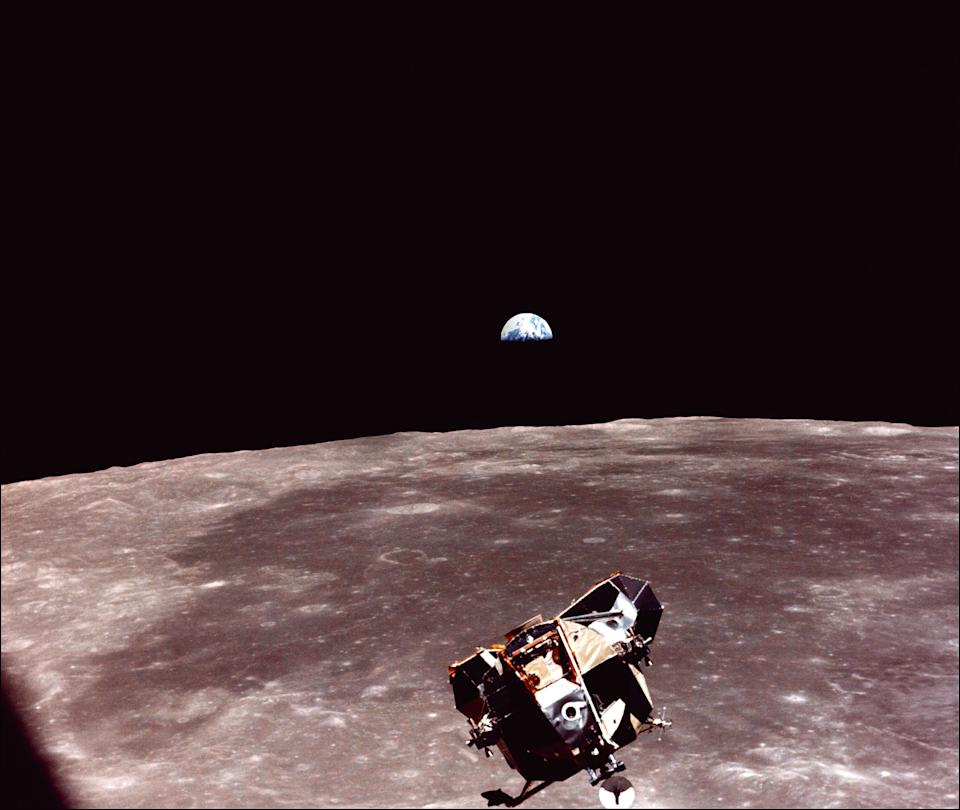 """The Lunar Module (LM) of the Apollo XI space mission, with US astronauts Neil Armstrong and Edwin Aldrin aboard, is seen in lunar orbit after its liftoff from the Moon's surface on July 21, 1969 in space as it approaches the Apollo 11 command """"Columbia"""" module for a rendez-vous. The large, dark-colored area in the background is Smith's Sea and earth rises above the lunar horizon.  (Photo: NASA/AFP/Getty Images)"""