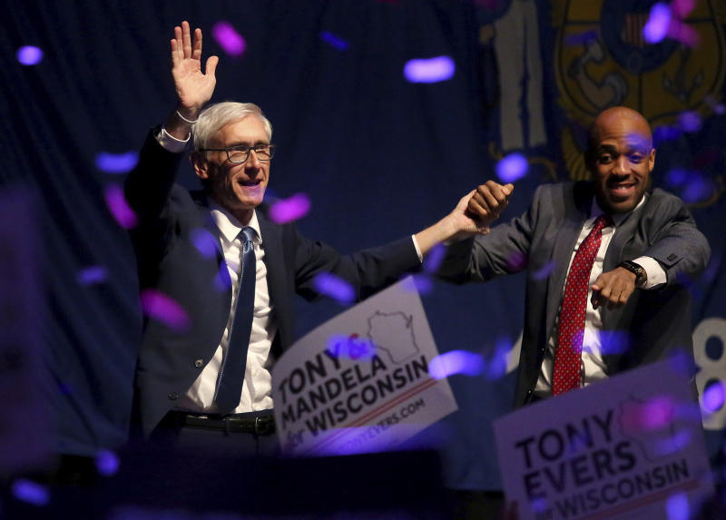 Wisconsin Democratic gubernatorial candidate Tony Evers, left, and Lieutenant Governor candidate Mandela Barnes appear at a post election party at the Orpheum Theater in Madison, Wis., Wednesday, Nov. 7, 2018. (John Hart/Wisconsin State Journal via AP)