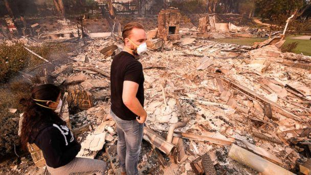 PHOTO: Alexander Tobolsky and his girlfriend Dina Arias return to his home where burned out by the fire in Malibu, Calif., Nov. 10, 2018. (Ringo H.W. Chiu/AP)