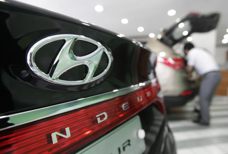 The logo of Hyundai Motor Co. is seen on its car at the company's showroom in Seoul, South Korea, Thursday, July 26, 2012. Hyundai Motor said its second quarter net profit rose 10 percent, driven by demand for its vehicles in overseas markets. (AP Photo/Ahn Young-joon)