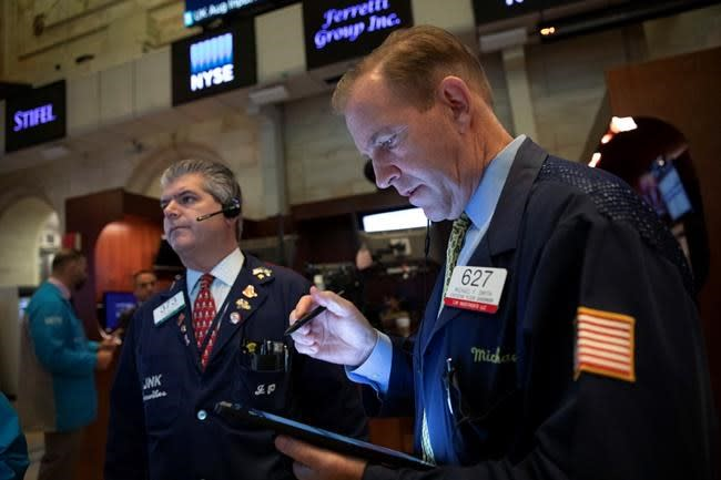 Markets Right Now: Stocks sink then recover after Fed cut
