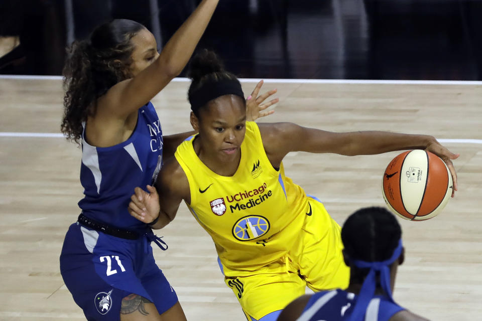 Chicago Sky forward Azura Stevens (30) drives against Minnesota Lynx forward Mikiah Herbert Harrigan (21) during the second half of a WNBA basketball game Thursday, July 30, 2020, in Bradenton, Fla. (AP Photo/Chris O'Meara)