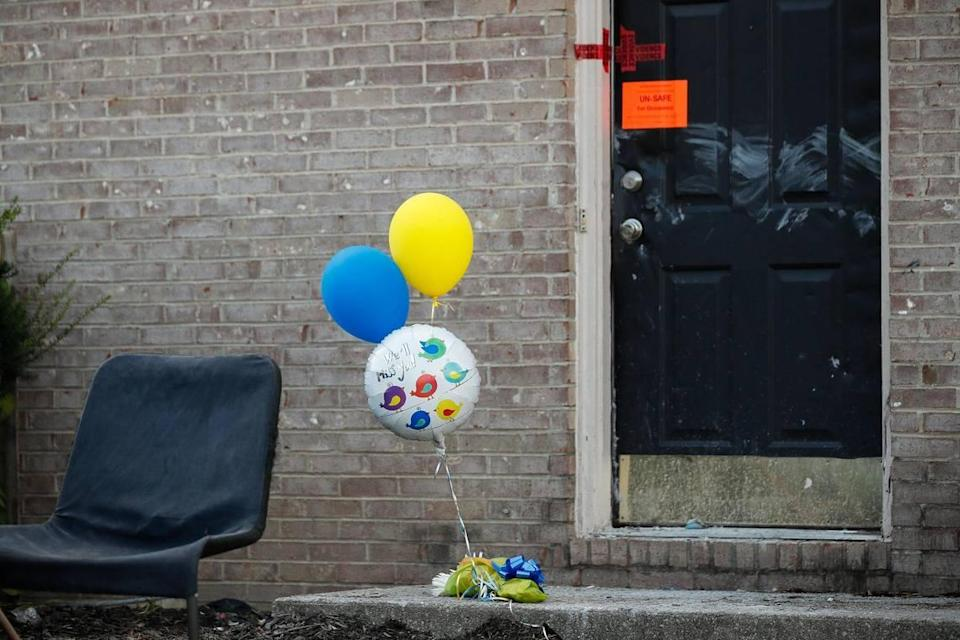 Balloons sat outside an apartment building on Keystone Drive in Richmond Wednesday, one day after Christopher and Gracie Hager were shot to death. Thomas C. Birl was charged.