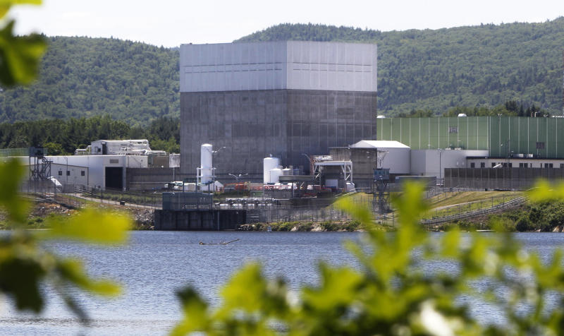In this June 19, 2013 photo, the Vermont Yankee Nuclear Power Station sits along the banks of the Connecticut River in Vernon, Vt. Entergy Corp., announced Tuesday, Aug. 27, 2013, it will shut down the nuclear power plant by end of 2014, ending a long legal battle with the state. (AP Photo/Toby Talbot)