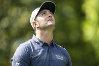 Jon Rahm reacts after his tee shot on the 3rd hole during the first round of the Wells Fargo Championship golf tournament at Quail Hollow Club on Thursday, May 6, 2021, in Charlotte, N.C. (AP Photo/Jacob Kupferman)