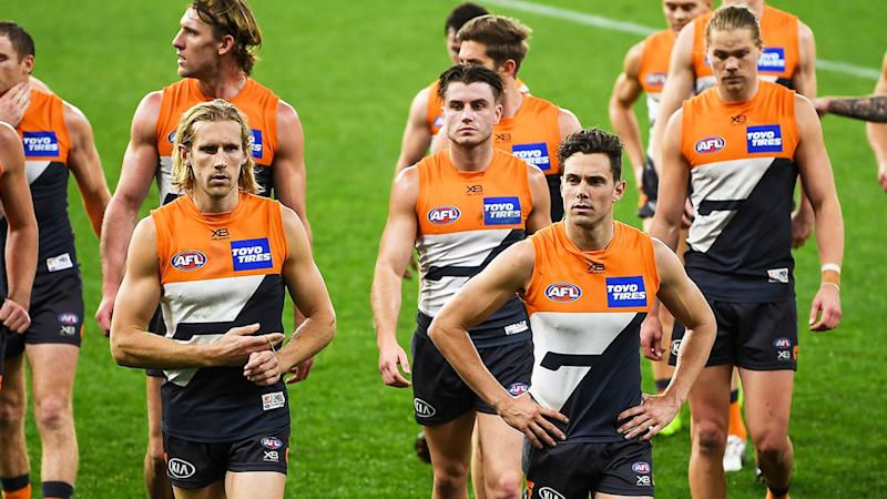 GWS Giants players, pictured here leaving the field after their loss to Sydney Swans.