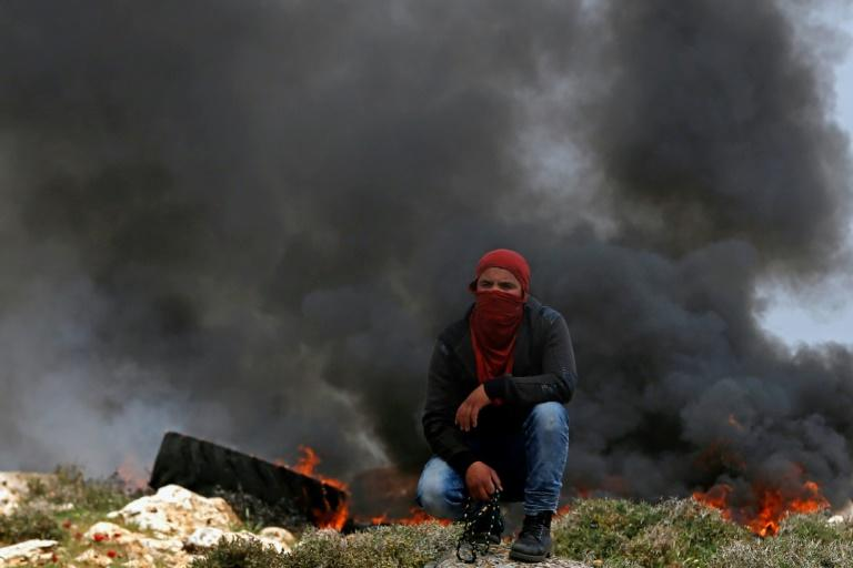 A Palestinian protester seen during clashes with Israeli security forces following a demonstration against Jewish settlements near the West Bank city of Ramallah on March 24, 2017